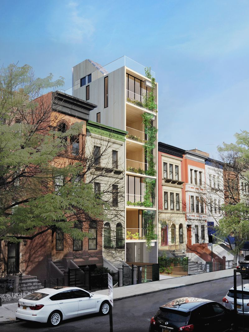 A rendering of a six-story apartment building with balconies and plants surrounded by old brownstone buildings.