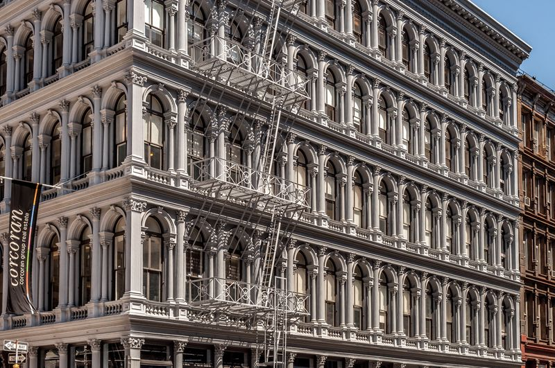 A large building with an ornate cast-iron facade in the Soho neighborhood in New York City.