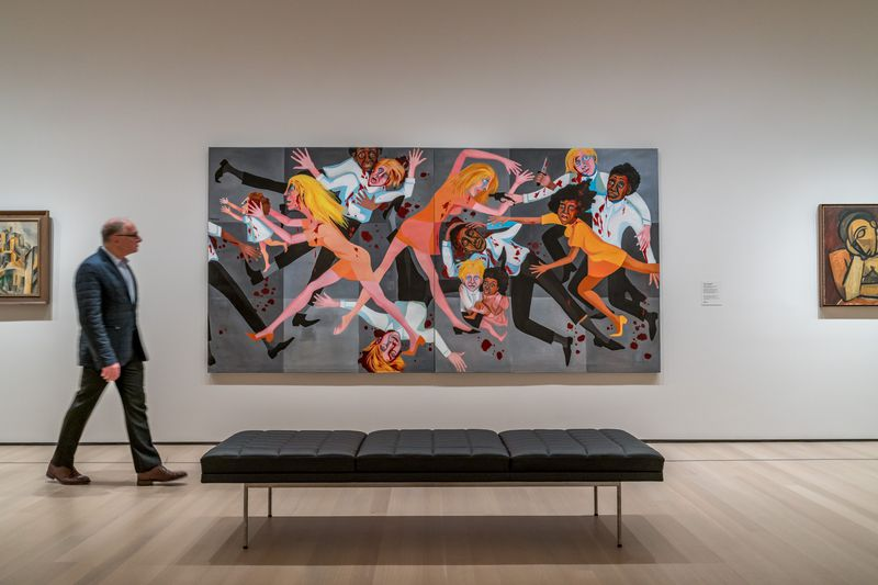 A painting hung on a wall in an art gallery. The painting depicts a group of people who are painted in an abstract way, who are fighting. There is a black bench in front of the painting.