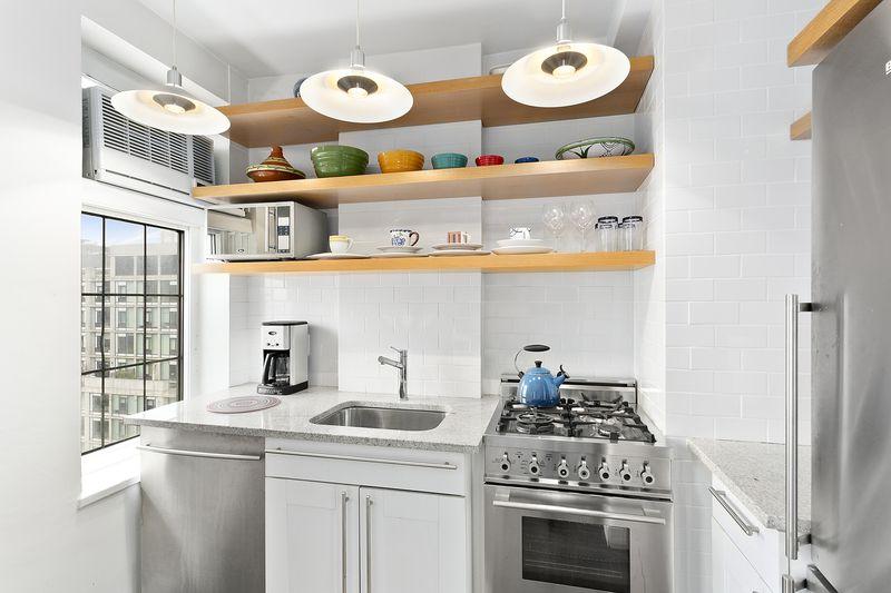 A kitchen with white tiles.