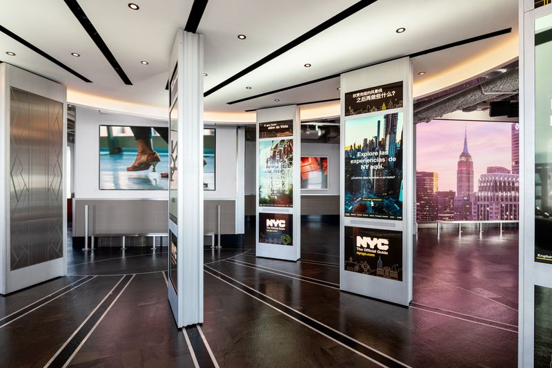Several floor-to-ceiling interactive screens.