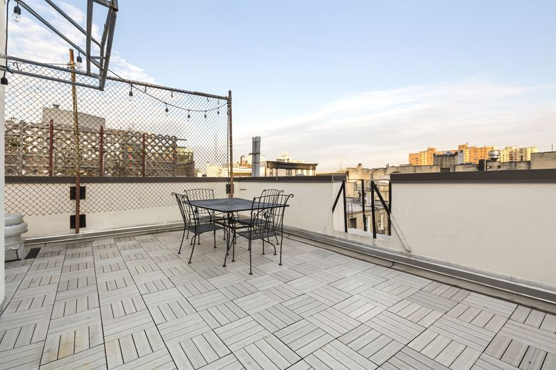 A roof terrace with a seating area.