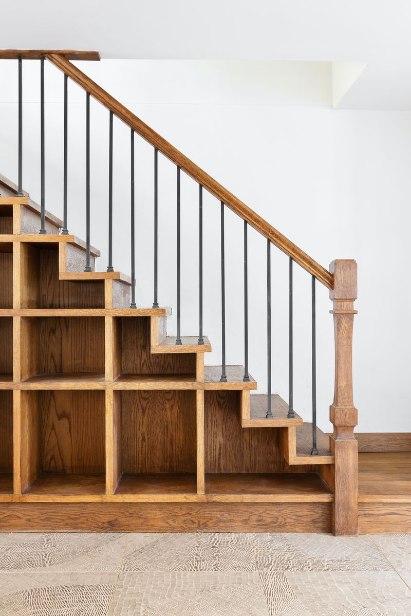 A staircase with shelves built into the side.