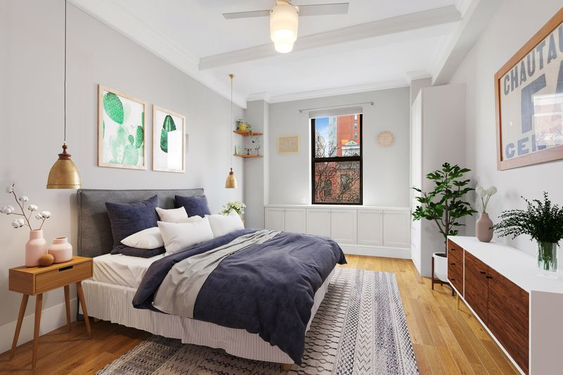 A bedroom with a large bed, hardwood floors, a planter, and a small window.