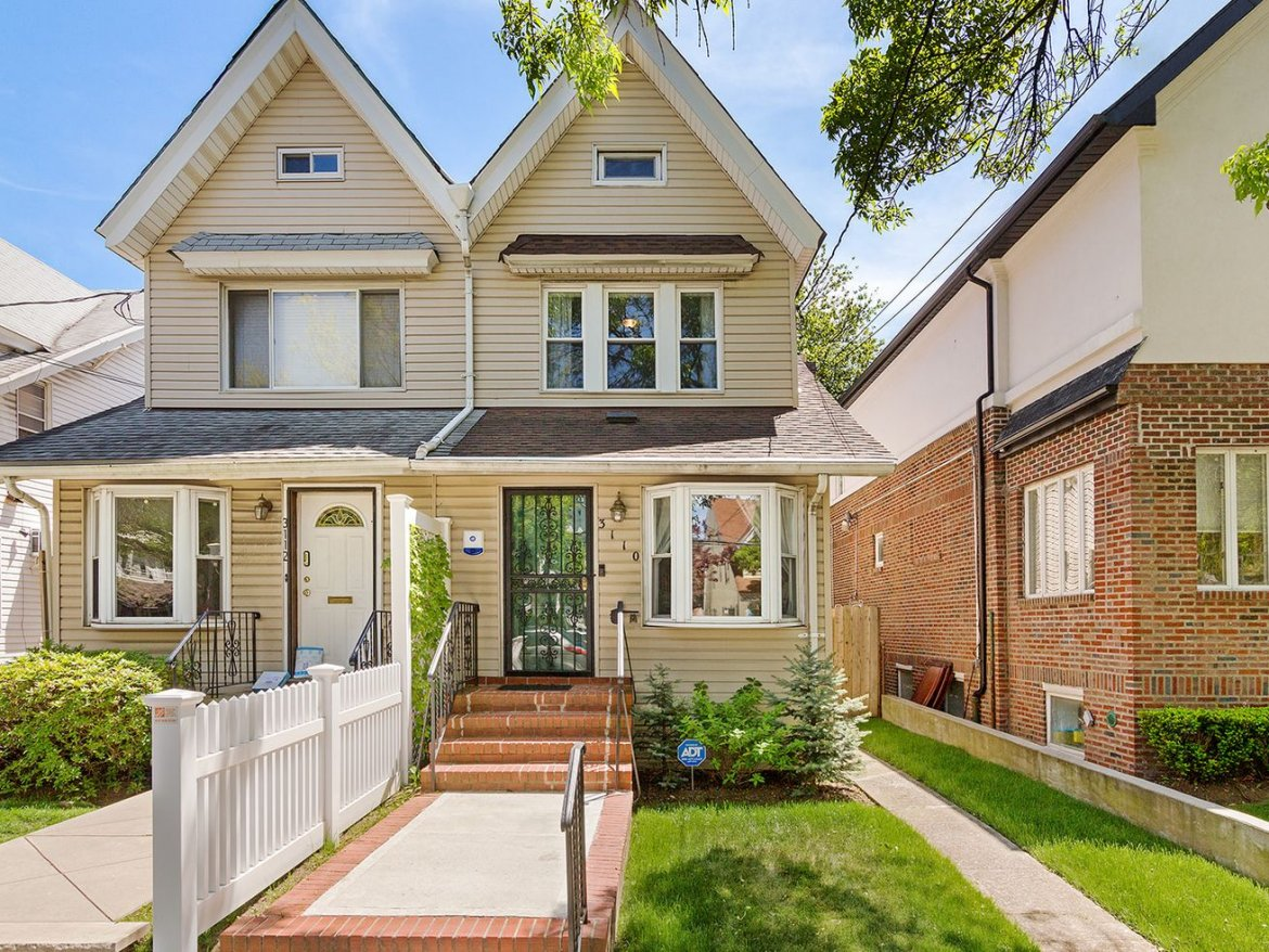 Two-story Midwood home with a backyard pergola asks $925K