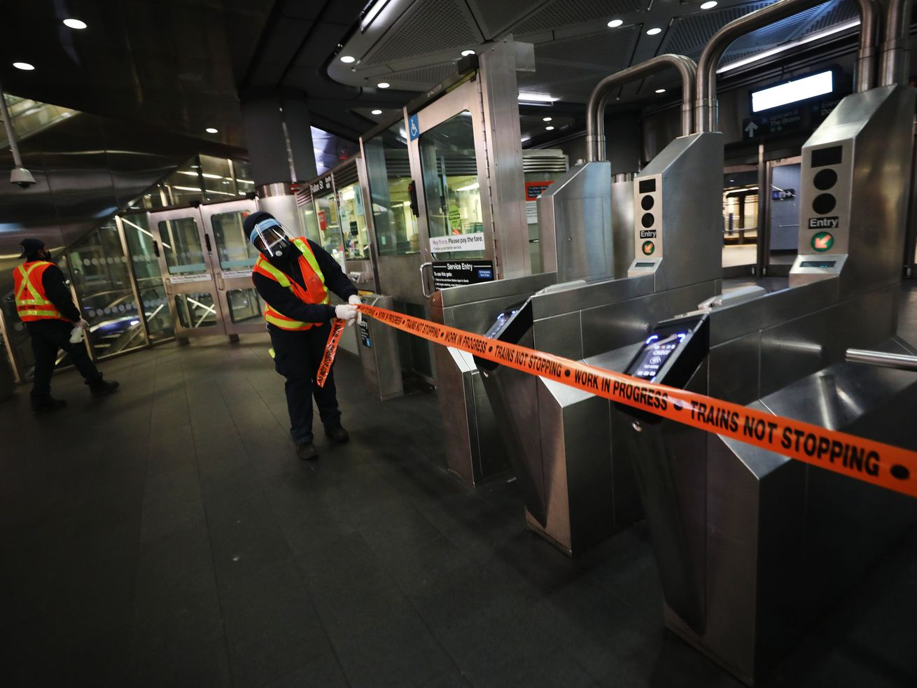Workers close down a station as the New York City subway system, the largest public transportation system in the nation, is closed for nightly cleaning due to the continued spread of the coronavirus.
